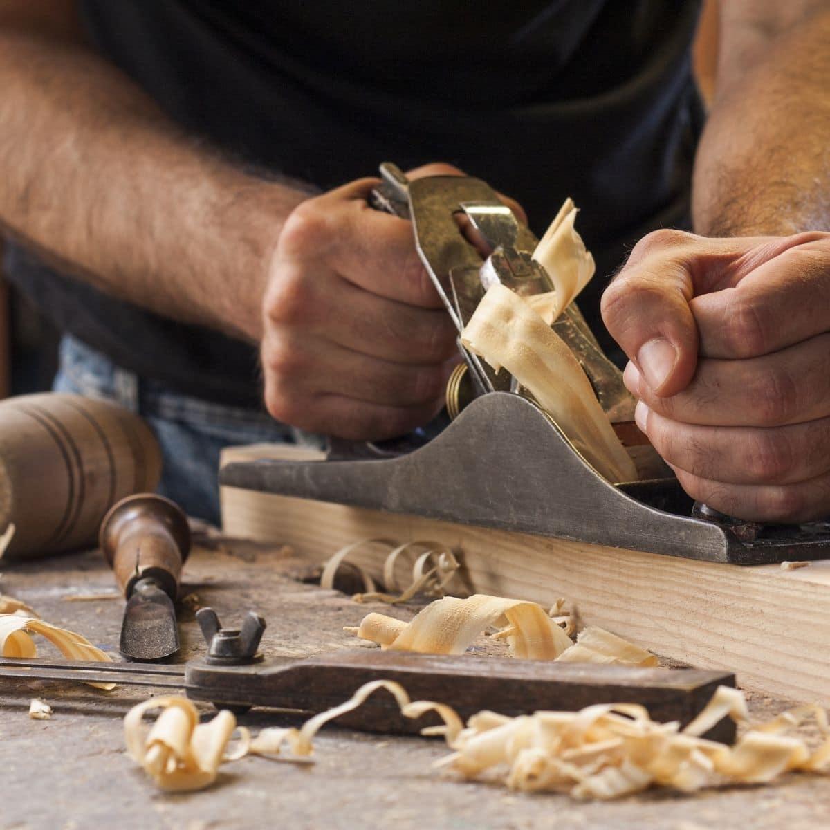 Preparing wood in woodworking shop.