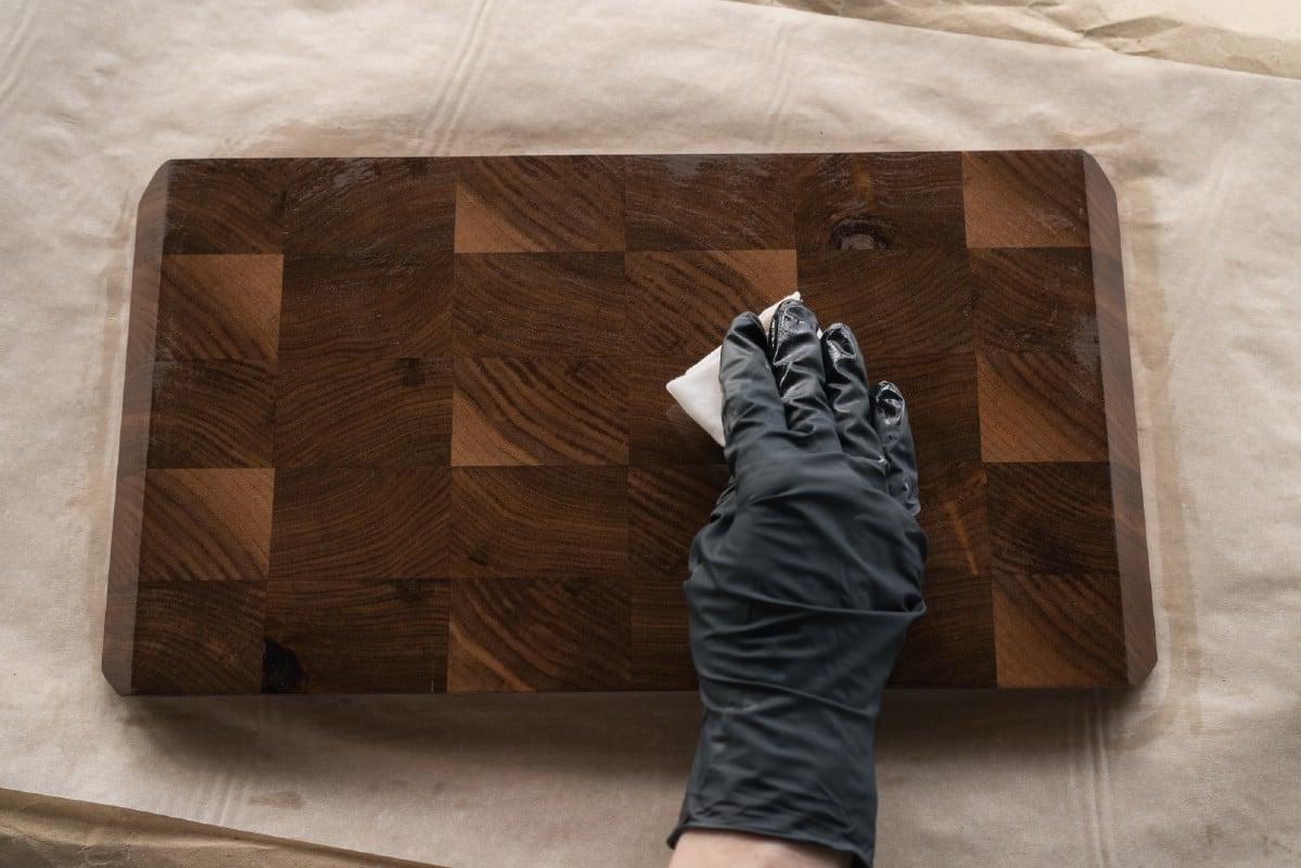 Applying walnut oil finish to a cutting board.